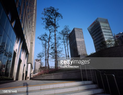Business man at modern office park in Seoul : Stock Photo