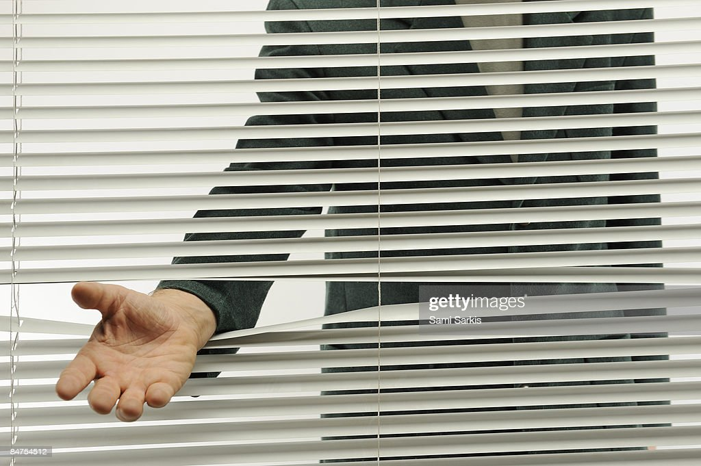 Business man behind blinds need help : Stock Photo