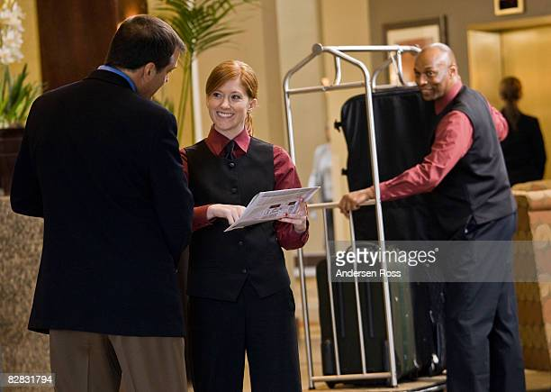 Business man being greeted by hotel staff