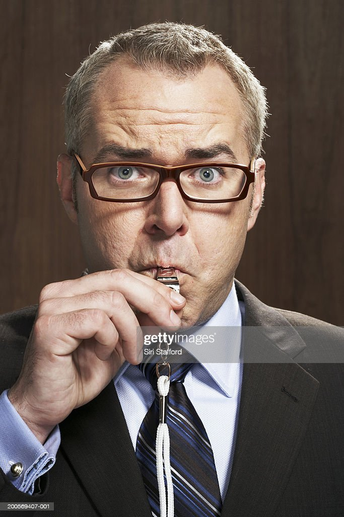 Business man blowing whistle : Stock Photo