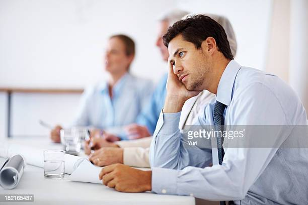 Business man bored during meeting