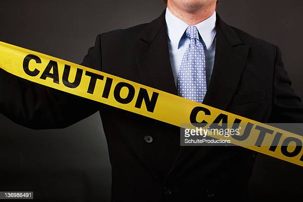 Business Man Caution Tape