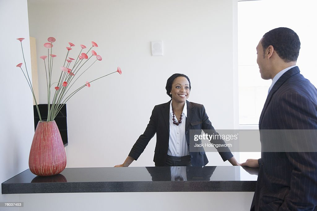 Business man checking in to hotel : Stock Photo