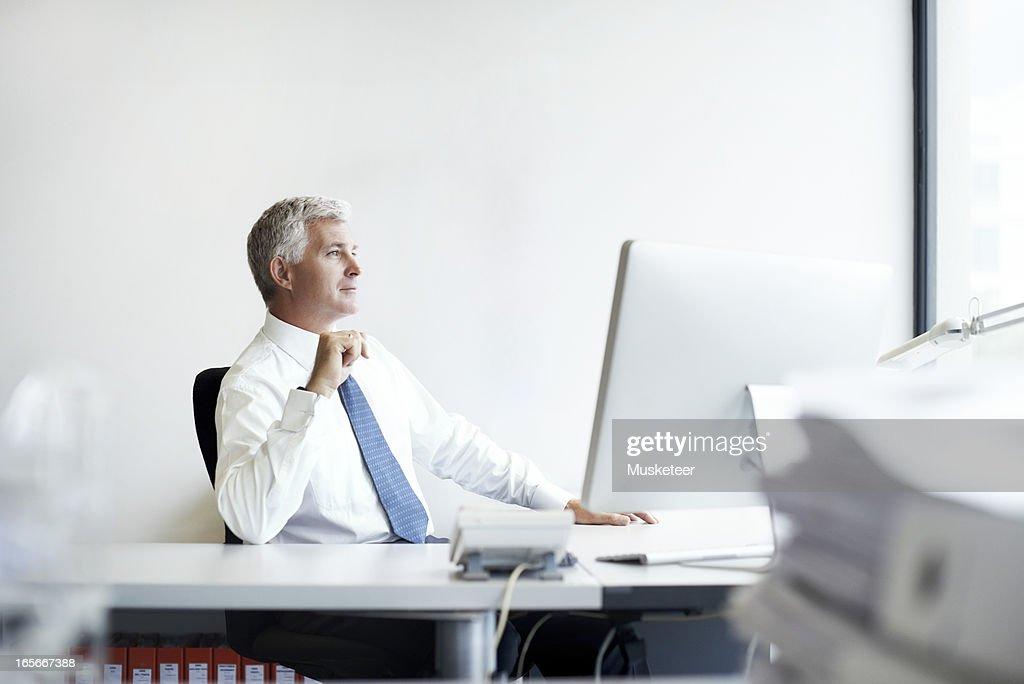 Business man contemplating the way forward : Stock Photo