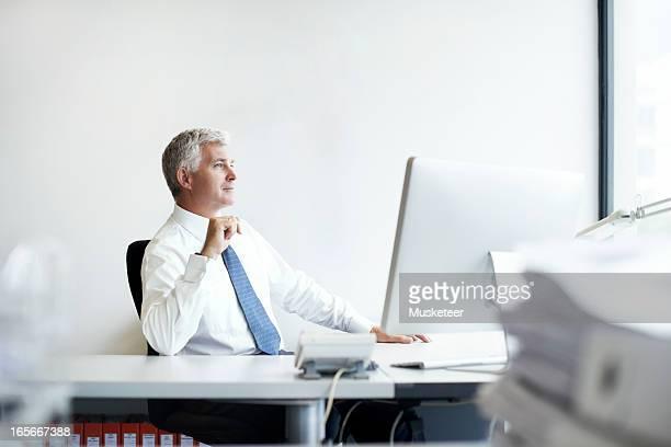 Business man contemplating the way forward