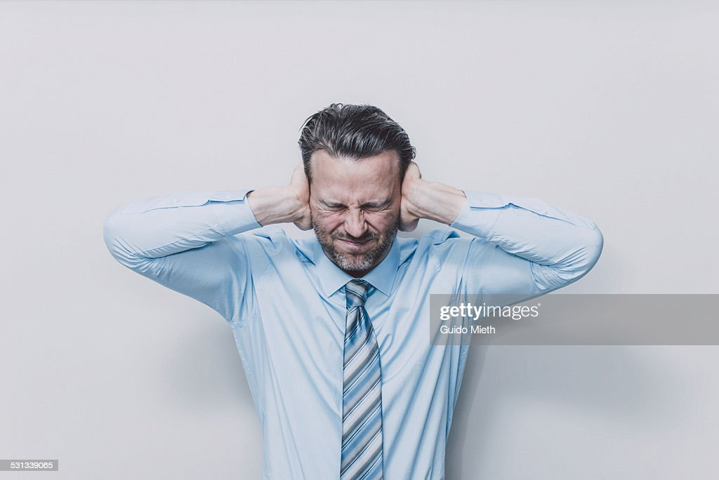 Business man covering his ears. : Stock Photo