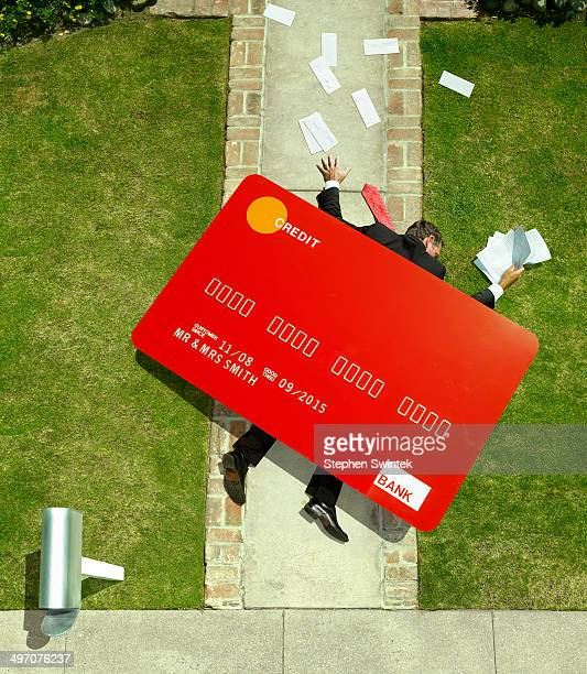 Business man crushed under oversized credt card