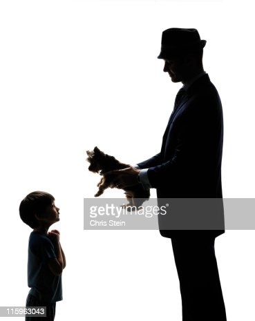 Business Man Dad Brings Son Home a Dog : Stock Photo