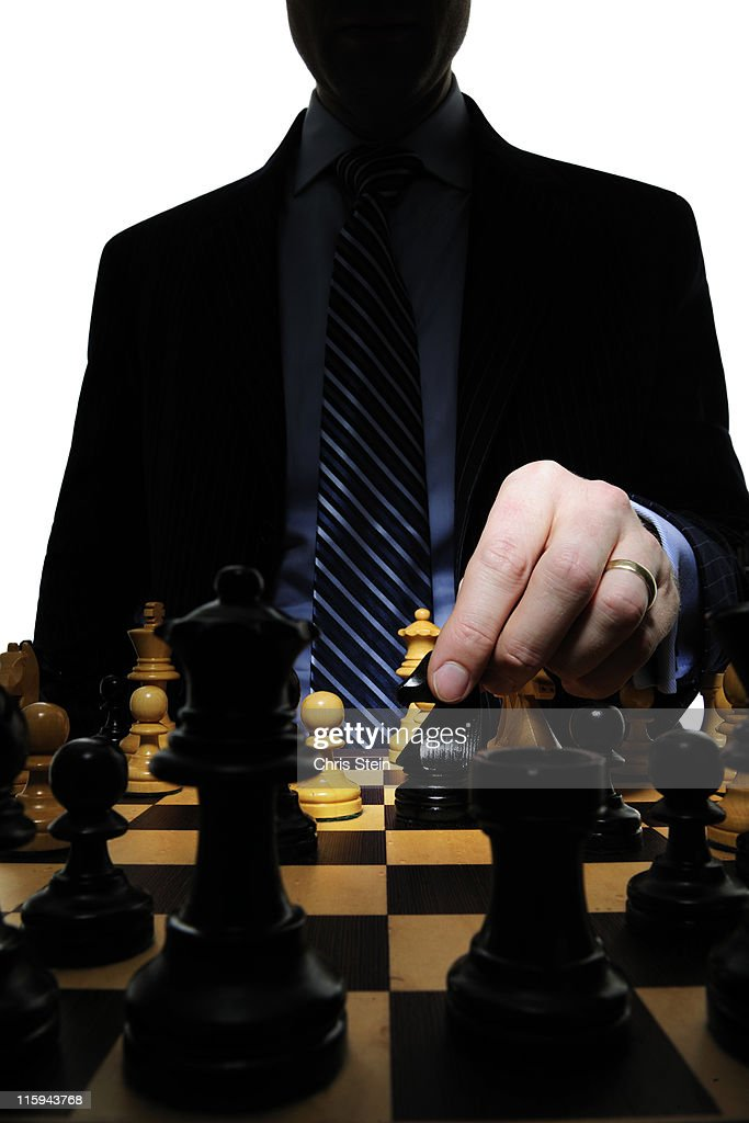 Business man dad playing chess : Stock Photo