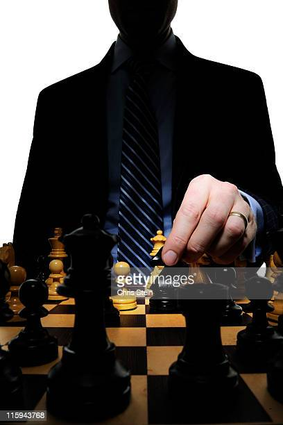 Business man dad playing chess