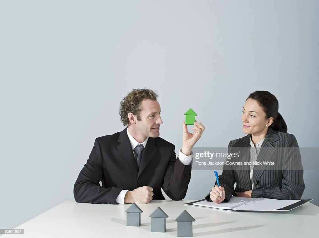 Business man discusses housing : Stock Photo