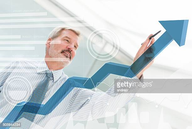 Business man drawing a growth graph