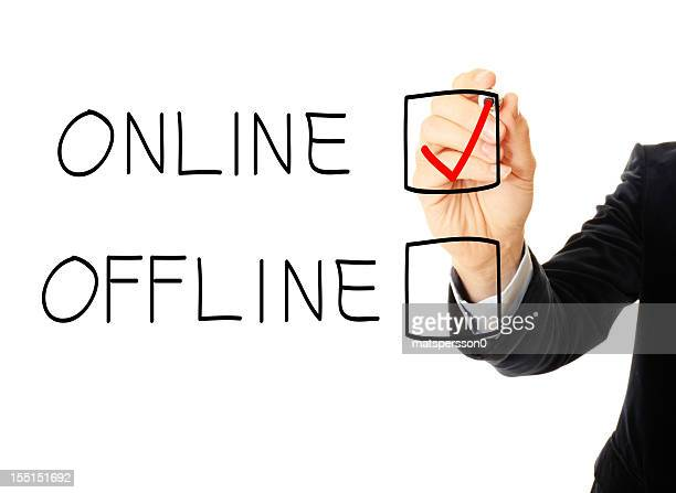 Business man drawing a online and offline check box