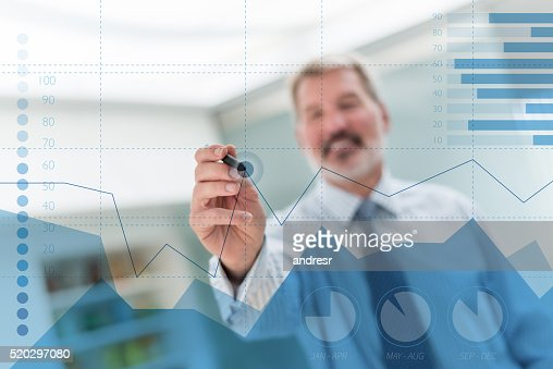 Business man drawing a statistics graph