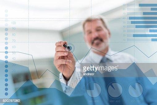 Business man drawing a statistics graph