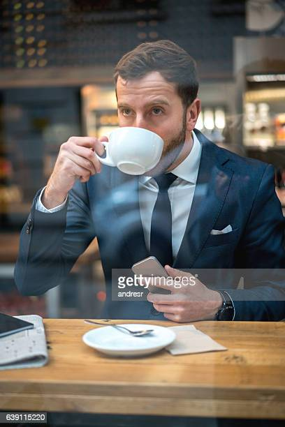Business man drinking a cup of coffee