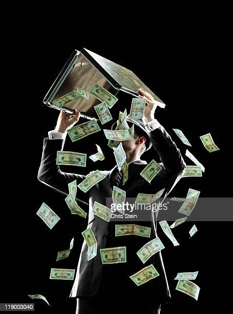 Business man dumping money