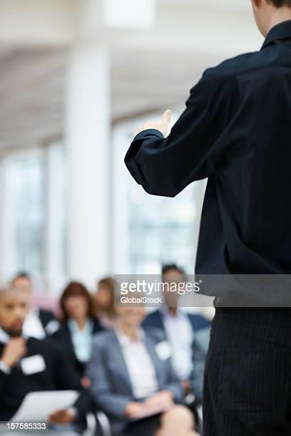 Business man during his speech at seminar