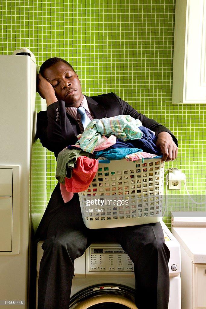 Business man fall in  sleep on washing machine : Stock Photo