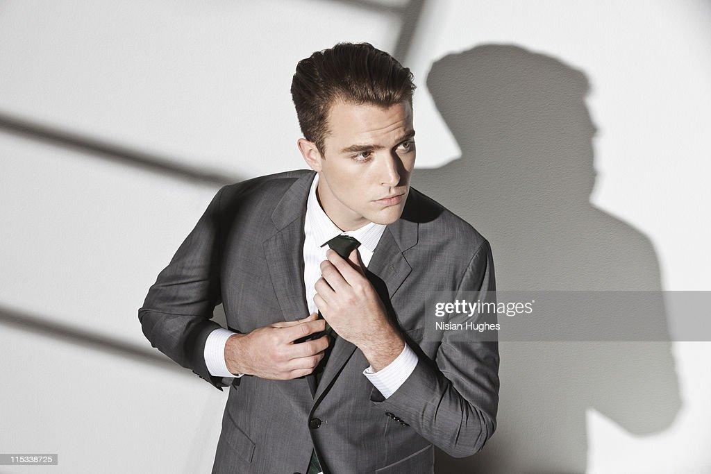 Business man fixing tie : Stock Photo