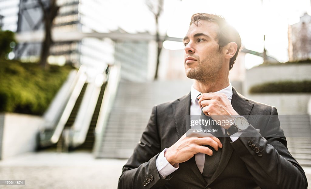 Business man getting dressed outdoors