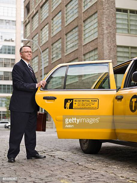 Business man getting into Taxi