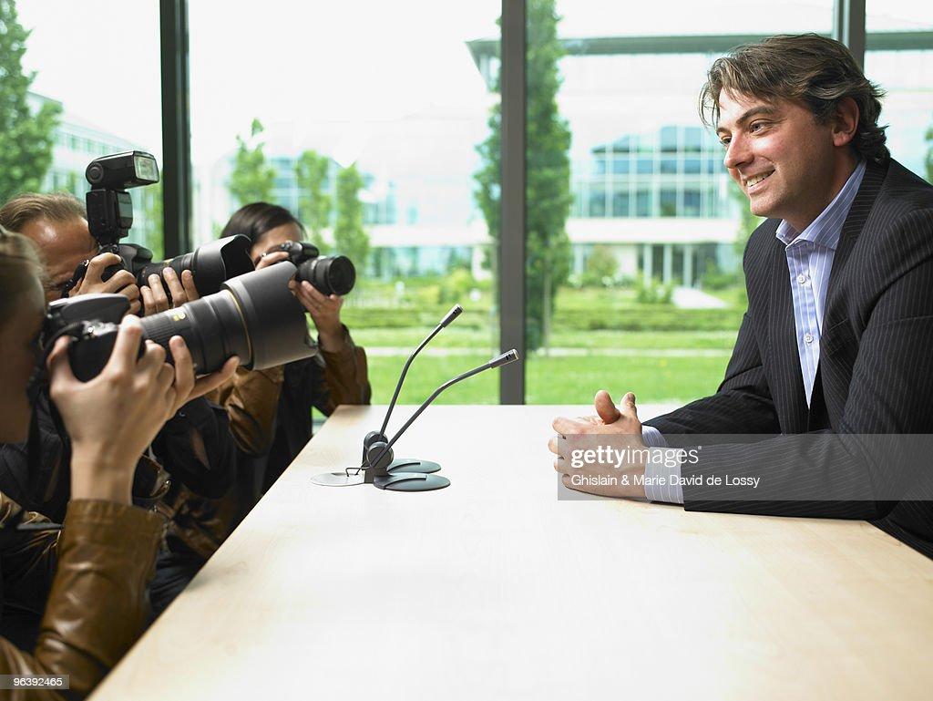 Business man giving a conference : Stock Photo