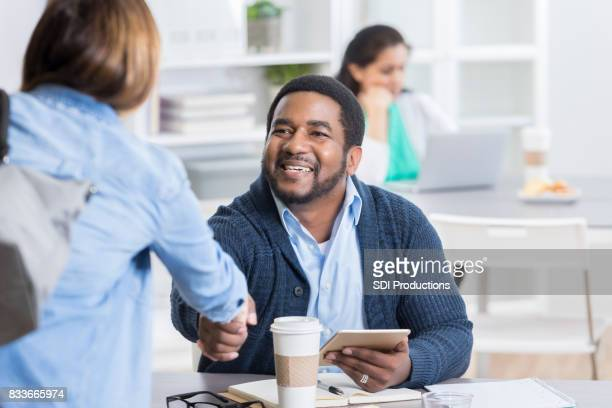 Business man greets colleague or client
