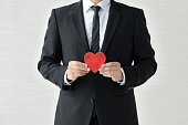 Business man having heart object