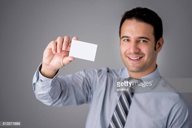 Business man holding a card
