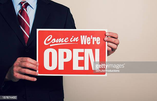 Business Man Holding Open Sign