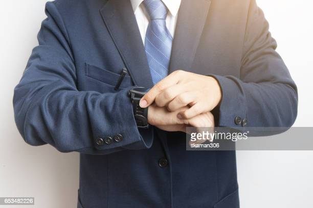 Business man holding smart-phone before meeting start up new project with white background
