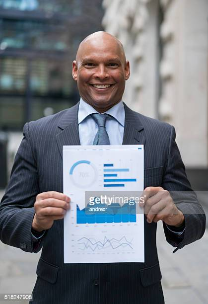 Business man holding statistics document