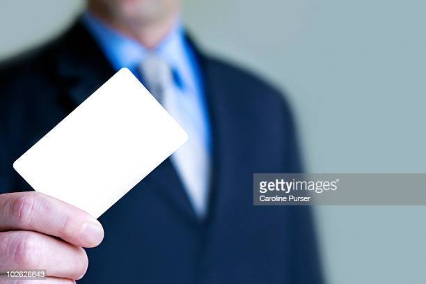 Business man holding up blank business card