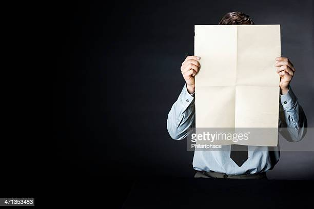 business man holding up blank newspaper