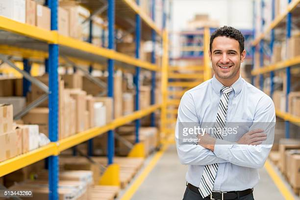 Business man in a warehouse