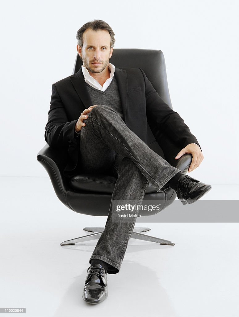 Business man in black chair. : Stock Photo