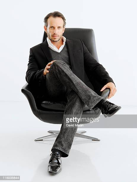 Business man in black chair.