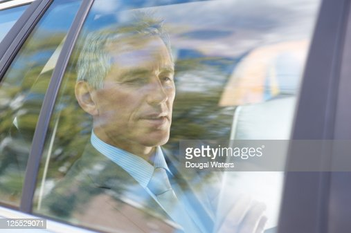 Business man in car using digital tablet. : Stock Photo