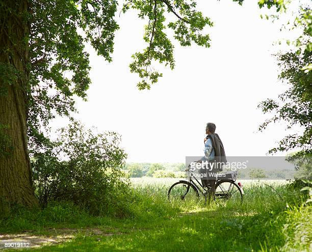 Business man in countryside with bike.