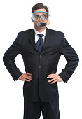 A businessman dons mask and snorkle