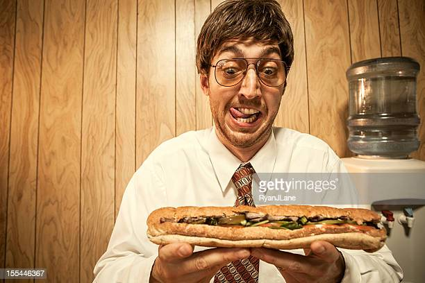 Business Man in Office With Sandwich