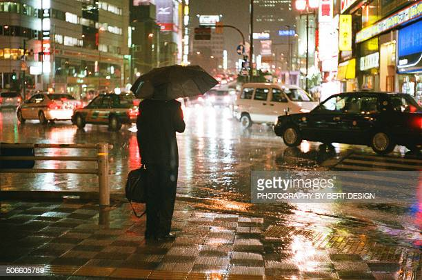 Business man in the rain at night Tokyo