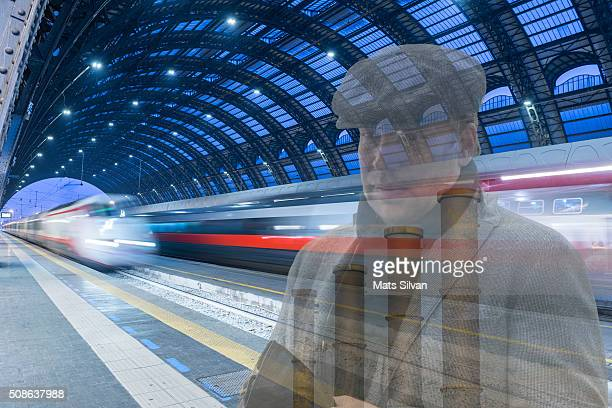 Business man in train station