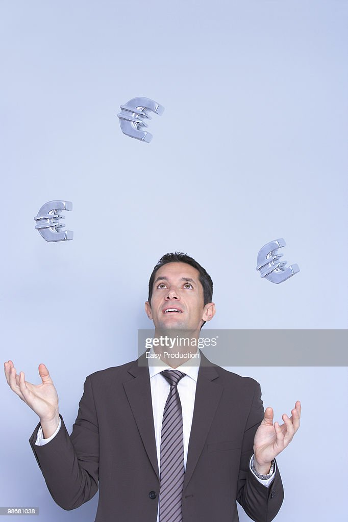 business man juggling with euros