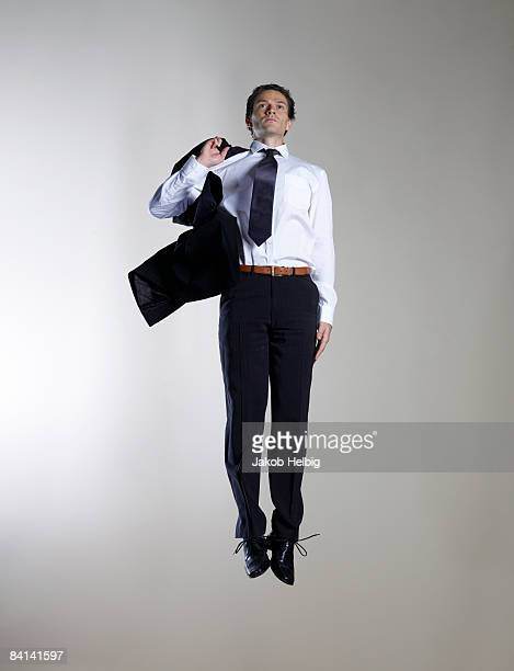 Business man jumping, suspended in the air