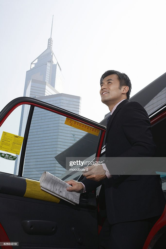 Business man jumping with blank sign above city : Stock Photo