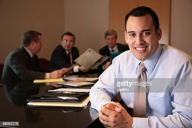 Business man leading his team at the office