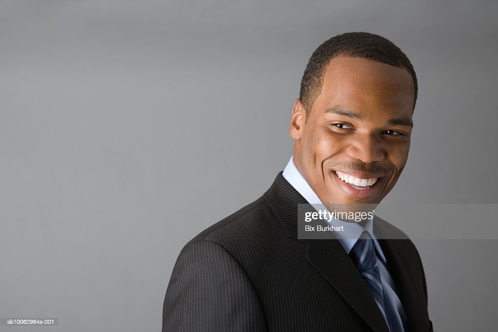 Business man looking away and laughing : Stock Photo