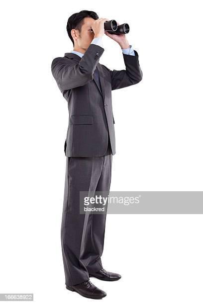 Business-Mann, Blick durch das Fernglas